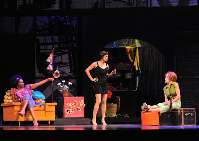 Vanita Harbour, Milena Govich, and Kathryn Murphy in Lyric Theatre's SWEET CHARITY. Photo by Wendy Mutz.